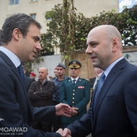 Deputy Prime Minister Ghassan Hasbani lays wreaths of flowers at the assassination site of President Rene Moawad in Zarif