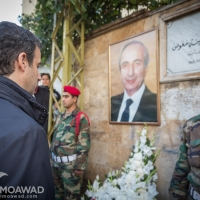 Ramzi Jreij lays wreaths of flowers at the assassination site of President Rene Moawad in Zarif